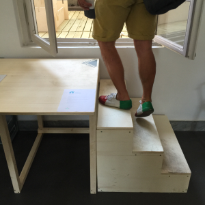 Great confidence in the durability of Open Desk's furniture (also used as makeshift stairs)